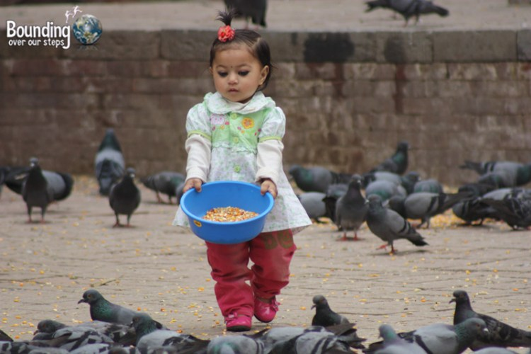 People of Nepal - Girl with Pigeons Compassion
