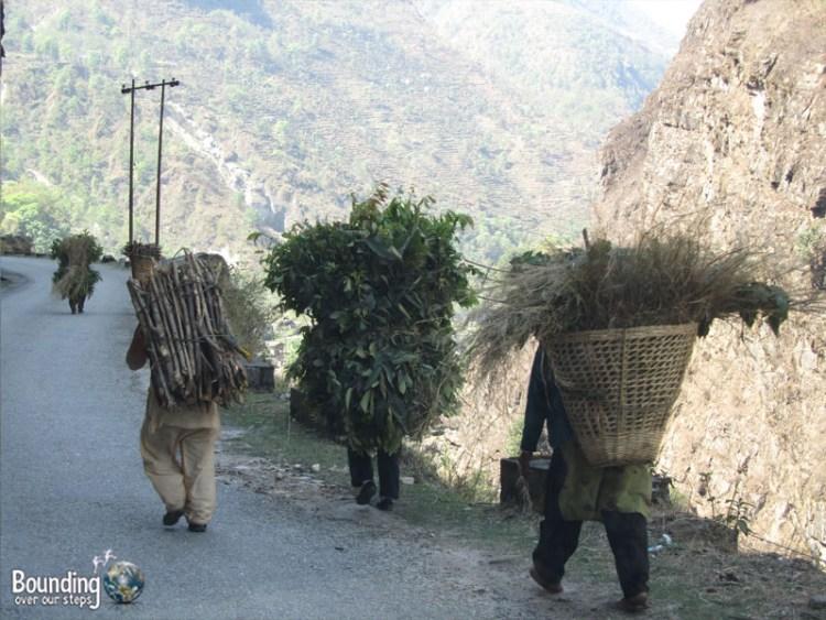People of Nepal - Men Carrying Bushels