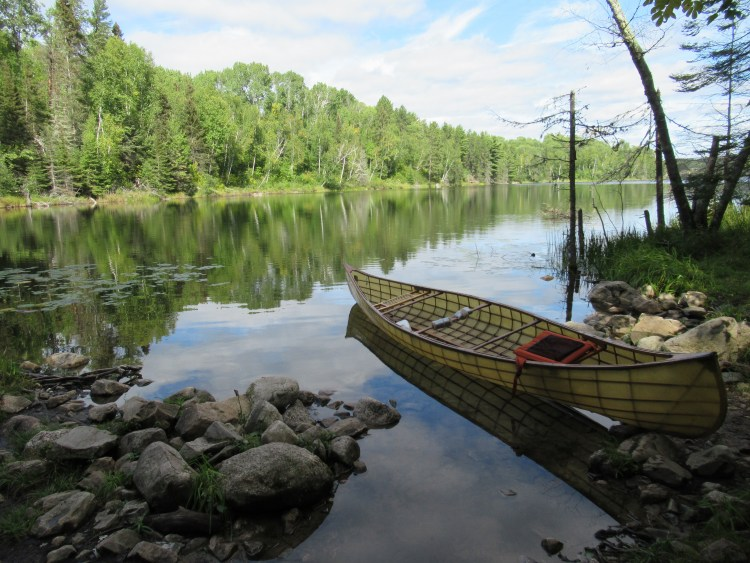 Handmade canoe sits in Sandhill Lake in the Boundary Waters Canoe Area (BWCA)
