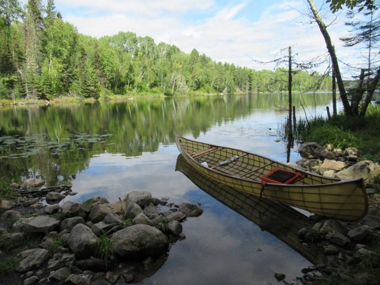 Handmade canoe sits in Sandhill Lake in the Boundary Waters Canoe Area (BWCA)