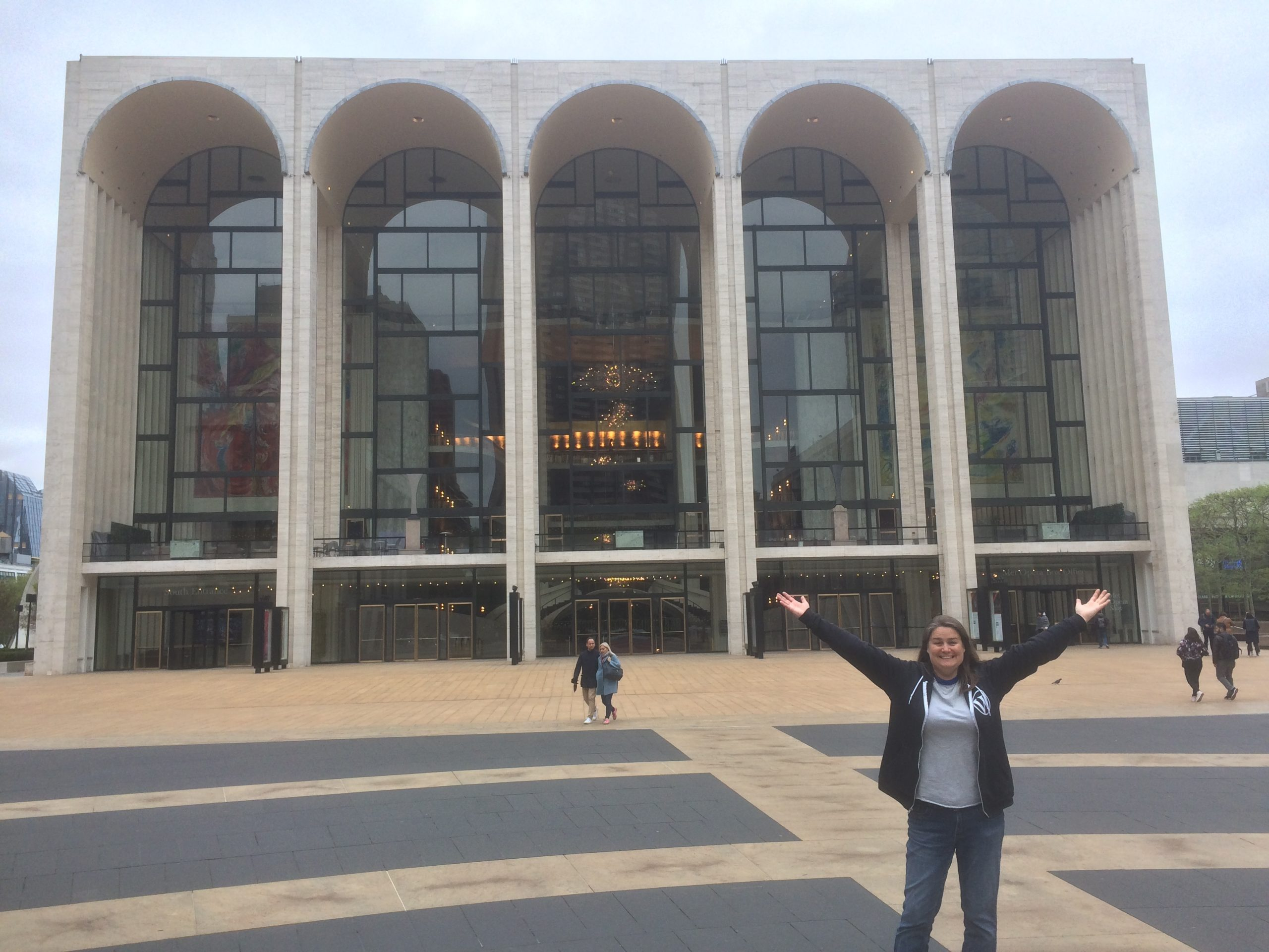 Me standing in front of the Metropolitan Opera House with arms wide open
