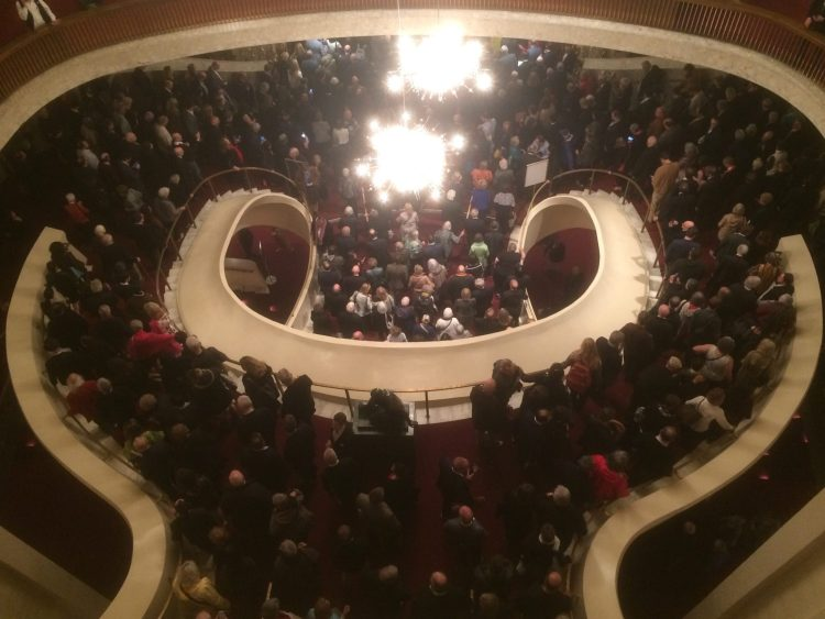 Looking down from the balcony at people leaving after the final performance
