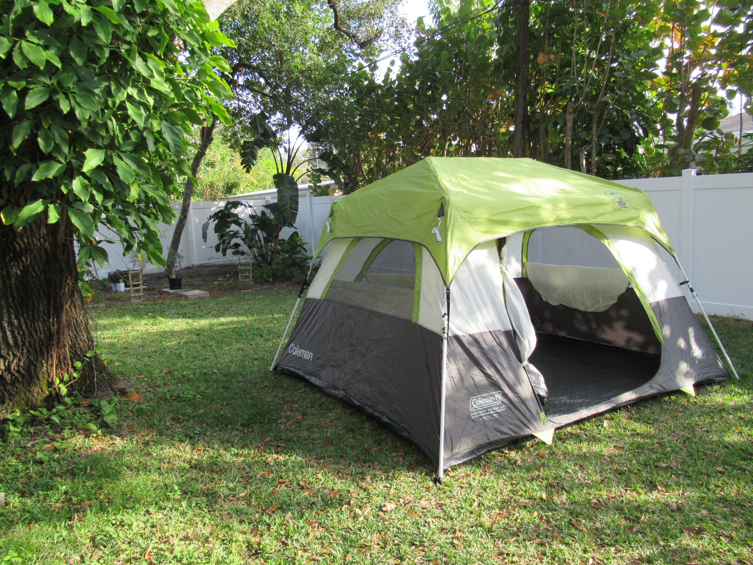 A tent set up for camping in the backyard
