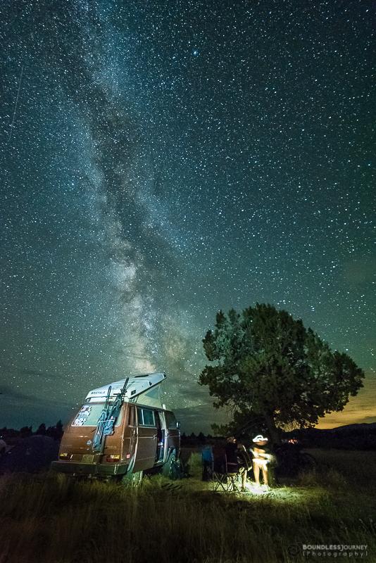 Milky Way over a Volkswagen Westfalia van in the Painted Hills of the Oregon desert. Boundless Journey.