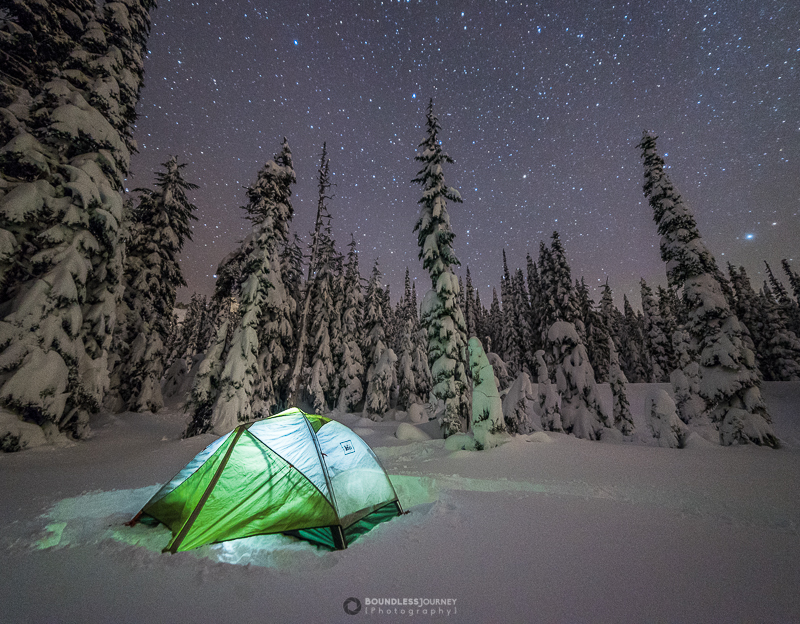 An REI tent in the snow during a winter camping trip at Mt. Rainier National Park. Boundless Journey Photogrpahy.