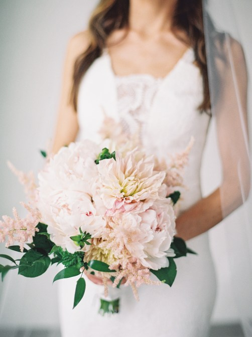Cafe au lait, blush peony and astilbe in a bridal bouquet.