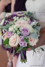 Bridal bouquet of lavender roses, Sahara roses, and dusty miller.