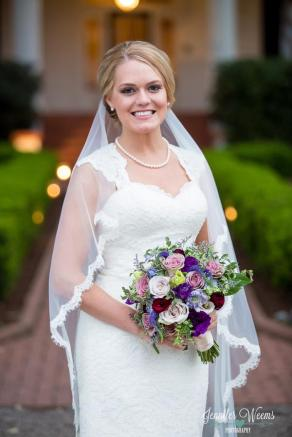 Bridal bouquet of purple, ivory and plum blooms.