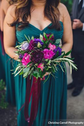 Teal bridesmaid gown accnented with rich fall tones in shades of fuchsia and Burgundy.