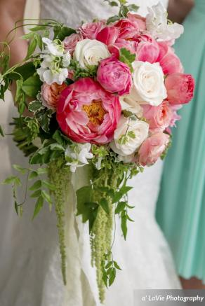 Coral peony with hanging amaranthus