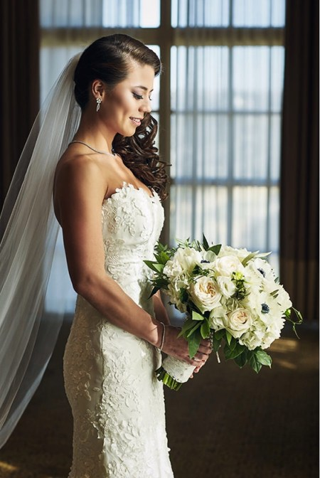 Bride with all white winter bouquet at Barton Creek Country Club.