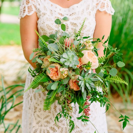 Succulents and garden roses with textural foliage.