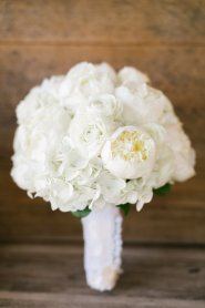 All white bridal bouquet of white peonies, hydrangea and ranuncula