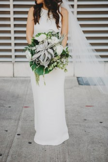Organic bouquet of tillandsia and assorted greenery for a modern bridal bouquet.
