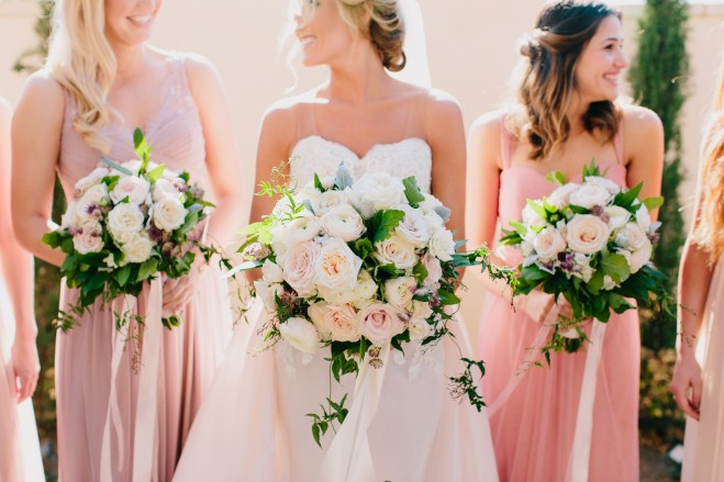 blush and cream bouquets for bride and bridesmaids in a winter wedding.