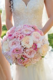 Bridal bouquet of pink roses, pink ranunculi and White Share garden roses.