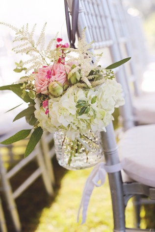 Rustic hobnail vase hanging on aisle chair