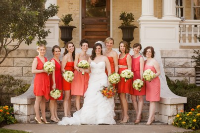 Wedding party-colorful bride with neutral bridesmaids.