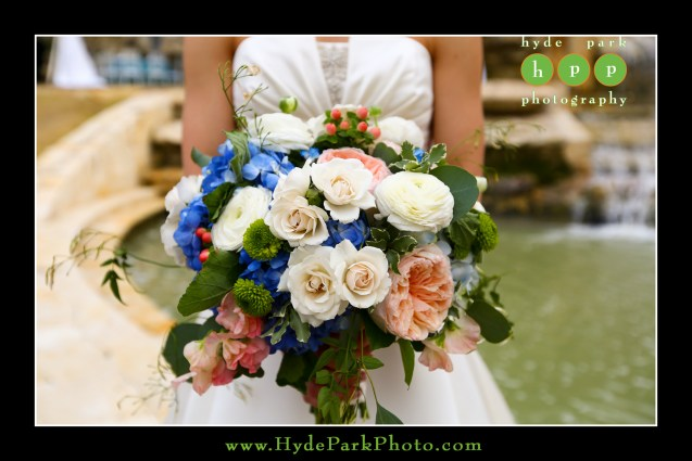 Lush, garden style bridal bouquet- soft ivory, peach and pops of blue.