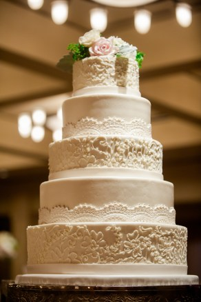 Only a few flowers to complement the gorgeous patterns of the cake tiers.