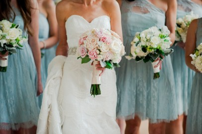 Sweet pastel bouquet for the bride and elegant all white and green selections for the bridesmaids.
