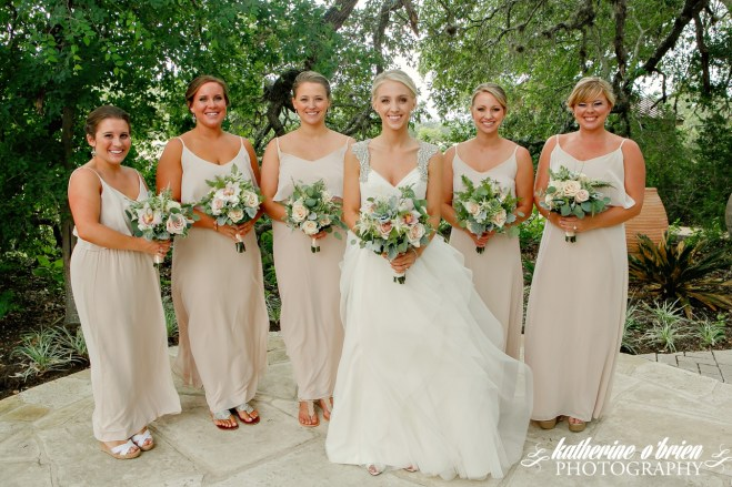 Champagne dresses accented with a variety of foliages,succulents and blush tones.