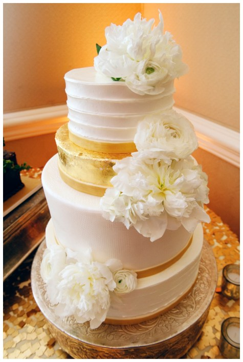 Fresh flowers for gold leaf accented cake