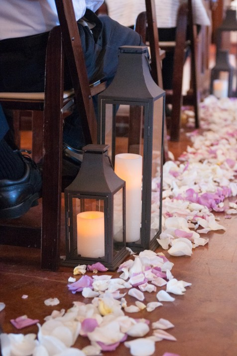 Aisle decor for indoor wedding ceremony.