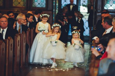 Flower girls with flower crowns and baskets of petals