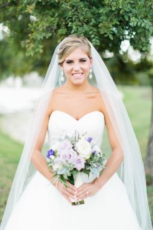 Summer bride with pastel flowers and shades of purples