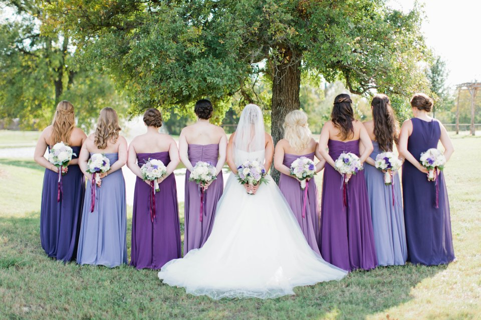 Variety of purple gowns for bridesmaids