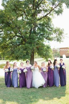 Bridesmaids in shades of purples with cascading ribbons