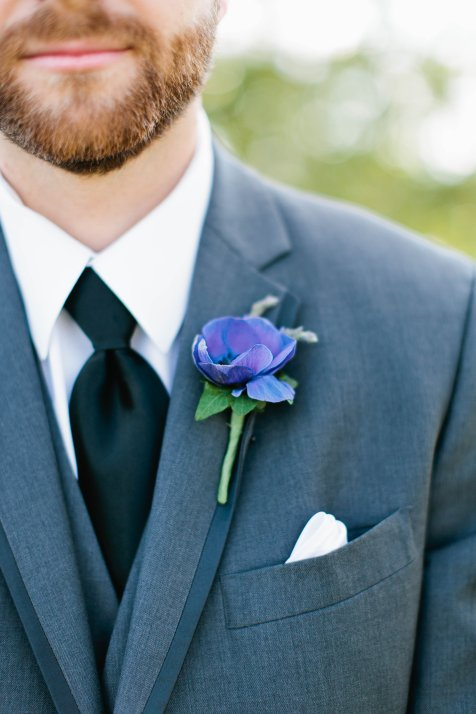 Purple anemone for boutonniere.