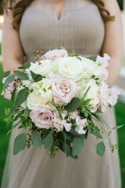 Bridesmaids bouquet for neutral bridesmaids gown with blush roses and garden foliages.