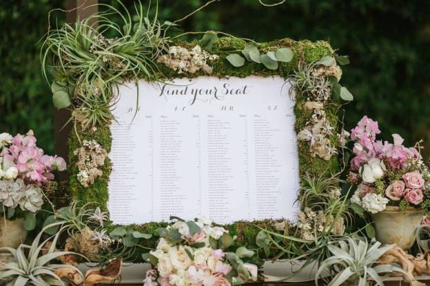 Escort card frame of tillandsia and foliages.