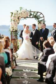Pinterest inspired willow arch with assymetrical arrangement of blush and white flowers.