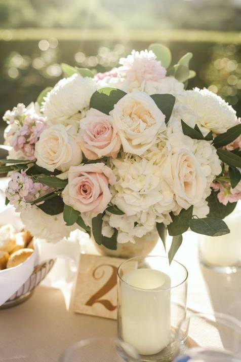 Outdoor reception table centerpiece, urn filled with blush and ivory garden roses.