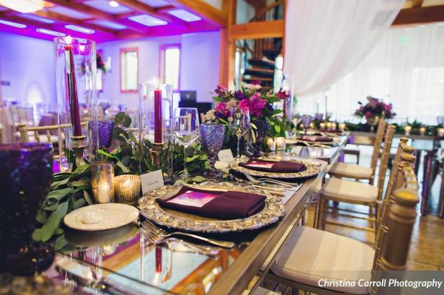 Head table at reception with rich jeweltones.
