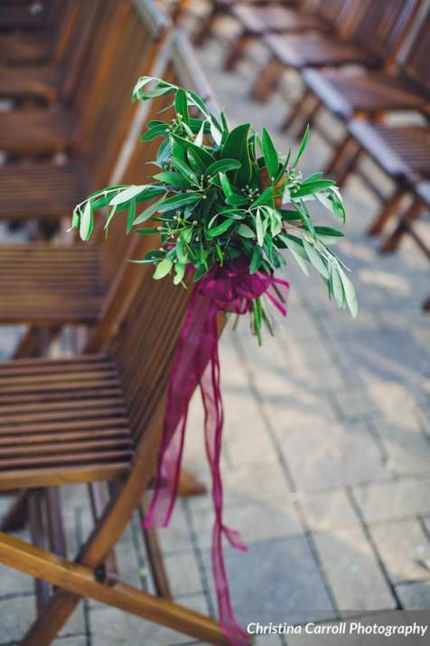 Bay and olive foliage with ribbon for chairs.