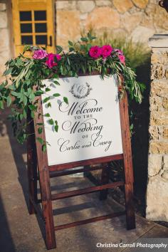 Welcome sign with foliage and flower garland
