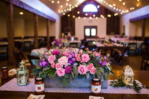 Rustic centerpiece in wooden box and colorful blooms