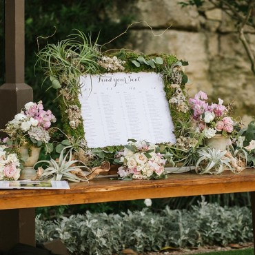 escort card sign greenery