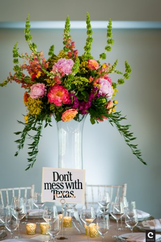 Tall colorful centerpiece for wedding reception at Canyonwood Ridge.