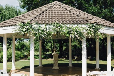 Outdoor gazebo with floral decor.