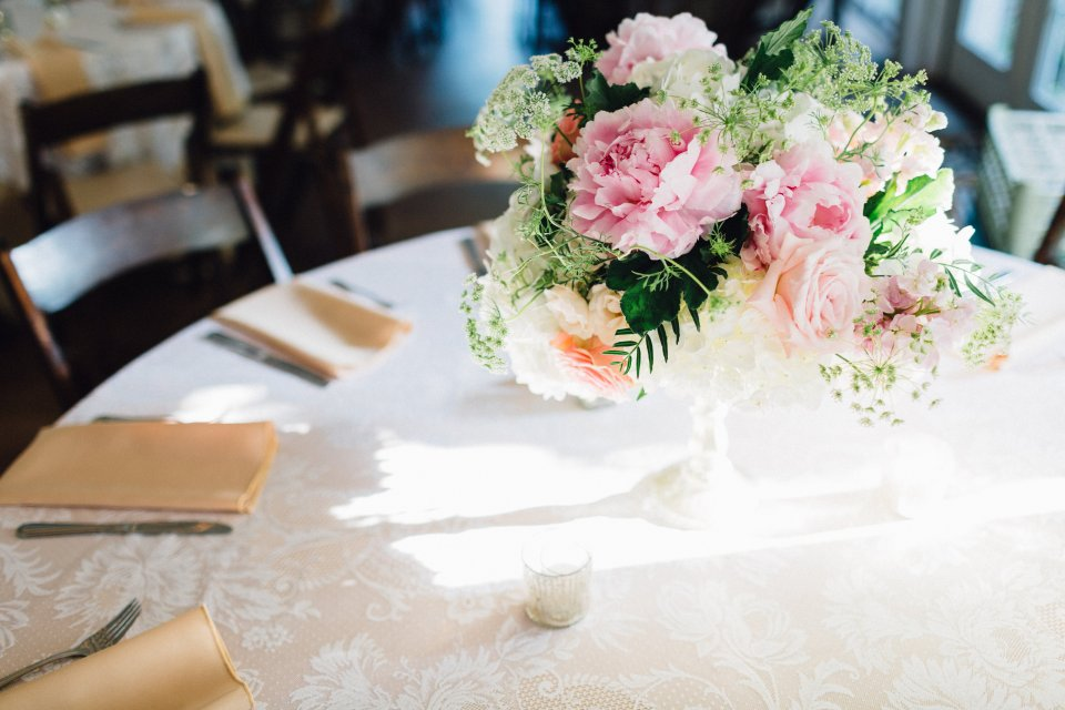 Low table centerpiece with pink peony.