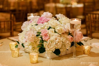White wooden box filled with white hydrangea, blush peony and shades of pink roses.