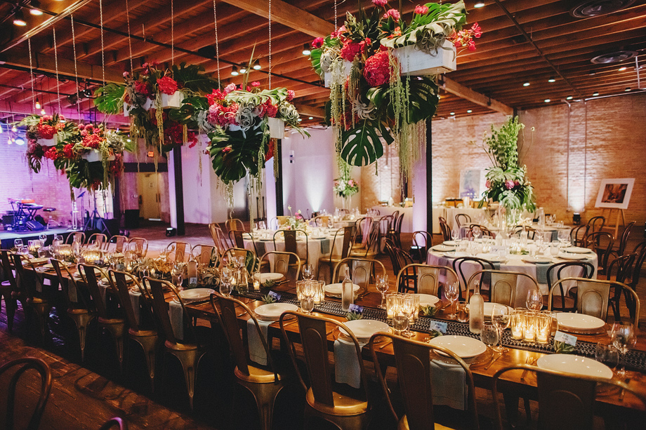 Brazos Hall with hanging boxes and centerpieces for wedding reception.