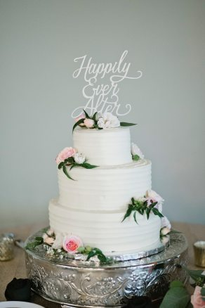 3 tier wedding cake with laser cut top and fresh flowers