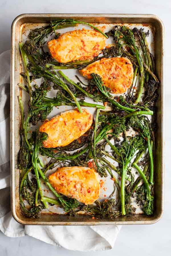 Roasted Harissa Chicken with Broccolini and Couscous | BourbonandHoney.com -- This Spicy Roasted Harissa Chicken is a super easy sheet pan supper, it's paired with broccolini and couscous and ready in about 30 minutes!