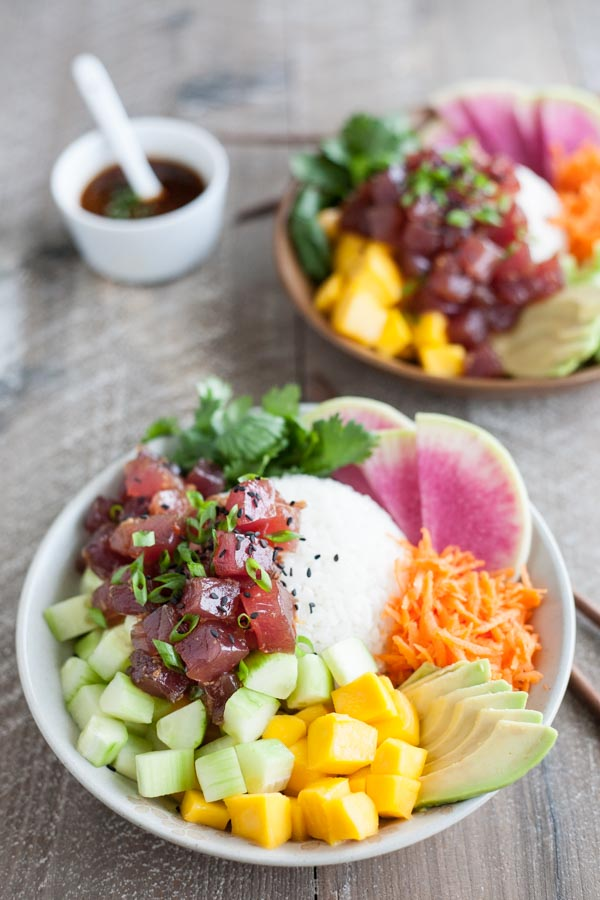 Ahi Tuna Poke Rice Bowl | BourbonandHoney.com -- This Ahi Tuna Poke Rice Bowl is straight from Hawaii! It's packed with fresh toppings and lots of tender tuna for a healthy, flavorful bowl.